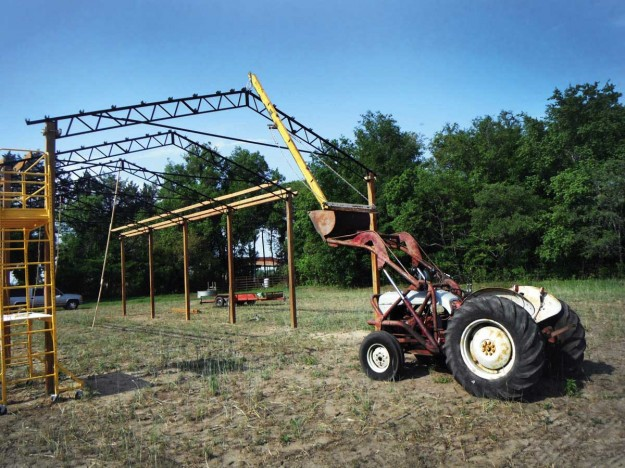 Pole barn with an 8N truss boom setting trusses