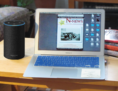 Alexa speaker next to laptop